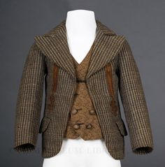 Boy's brown tweed jacket and wool vest, 1870-74. Clothing like this would have been appropriate schoolwear.