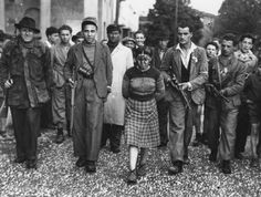 Italian partisans with a captured collaborationist.Milano.