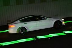 Drivers test the new Tesla 'D' model which is a faster and all-wheel-drive version of the Model S electric sedan at the Hawthorne Airport in Los Angeles on October 9, 2014.   While Tesla produces relatively few vehicles, it has become a star in the sector due to keen demand and a reputation for high quality. A surge in its share price over the past year has pushed its value over $30 billion.