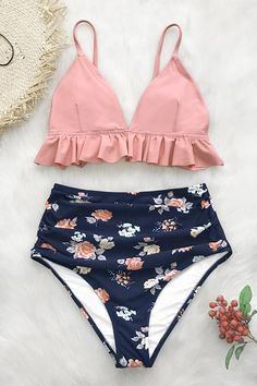 408ea246c5b72 Our Pink and Floral Ruffled High-Waisted Bikini set features a pink bikini  top with adjustable shoulder straps and ruffles under the bust.