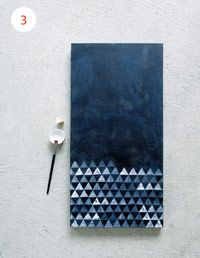 1)Paint canvas background with acrylic paint and let dry 2) Cut a triangle piece out of a potato 3) Dip potato piece in white acrylic paint and stamp away! *Tip-stick something in the potato piece to make it easier to handle. Like a toothpick maybe?. It wouldn't need to be fully covered in triangles either