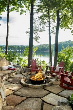 Situated on a narrow peninsula, the house boasts three-sided lake views best taken in from the patio surrounding the property's stone-encased fire pit.