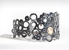 Oxidized silver cuff with 18K gold accent and champagne diamonds