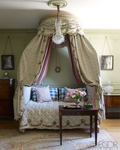 """A number of other rooms have acquired nicknames. A bedroom with a lit à la polonaise and family portraits of relatives of Marie Leszczynska, the Polish wife of Louis XV, became the Polonaise room. A cozy salon used for breakfast or tea was christened """"Miss Marple,"""" of Agatha Christie fame. """"Nobody understood the name,"""" Coorengel admits. In a guest room, an 18th-century lit à la polonaise is dressed in custom bedding and a canopy of hand-embroidered linen by Chelsea Textiles; the chandelier…"""
