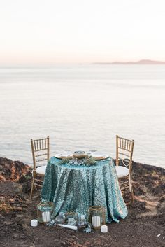 Seaside Sweetheart Table with Aqua Sequins and Copper Lanterns | B. Jones Photography | http://heyweddinglady.com/glam-mermaid-wedding-moonlit-coast/