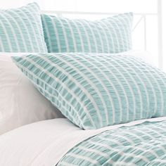 A pale sky blue-and-white stripe and inviting, smocked texture make this cotton sham an easy addition to beachy beds. Coordinate with any of our C3 bedding or accessories, including bath towels, storage bins, and cozy throws.  • 100% cotton.  • Knife edge.  • Envelop back with ties.