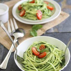 Zucchini Pasta With Avocado Cream Sauce Recipe with zucchini, avocado, cucumber, lemon, garlic, almond milk, basil, pepper, salt, basil leaves, cherry tomatoes