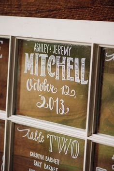 window and paint pen in lieu of escort cards   Justin & Mary #wedding