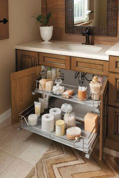 Unique U-shape fits around plumbing. With two trays, this sink base cabinet slide-out offers a great answer to a common problem.
