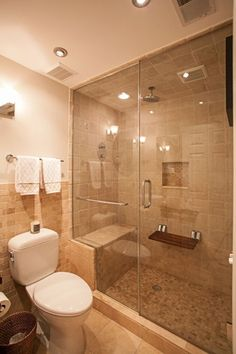 Contemporary 3/4 Bathroom with Standard height, three quarter bath, stone tile floors, Shower, can lights, Wall sconce, Paint
