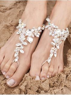 Chunky crystal & diamante barefoot sandals. The main body of the sandal is wired with beaded elasticaed loops at the toe & heel to make them one size fits all