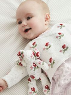 Goregous baby jumper knitting pattern from the Baby Cashmerino Book 5 by Debbie Bliss - Available at LoveKnitting