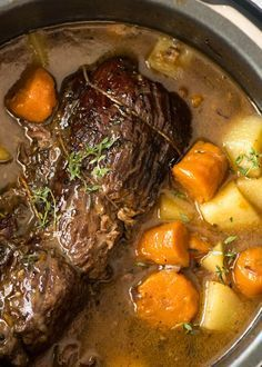 Slow Cooker Beef Pot Roast is the ultimate one-pot family meal! Meltingly tender meat, vegetables and potato, smothered in a wickedly delicious gravy.