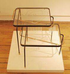 Deux tables gigognes en métal laqué noir, laiton et plateaux en verre gravé Mathieu Matégot France, c. 1950 H: 39/32 cm, L: 44 cm, P: 39 cm Prix sur demande