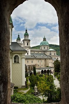 Salzburg, Austria.  Ever since I first saw 'The Sound of Music', I thought Salzburg looked like one of the most beautiful of old European cities, and as a photographer, who loves architecture, it makes me drool.  And yes, I'd probably take the Sound of Music Tour.  Or maybe just visit all the locations, if I could do it without the tour.  (I could do without the sing-along on the bus ......)