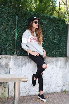 Torn jeans and coca cola tee