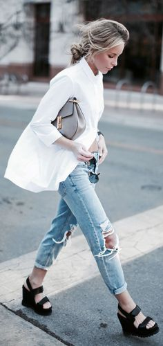 Street Style 2015: Mary is wearing a white shirt and ripped denim jeans from Topshop with a pair of Marc Jacobs wedges