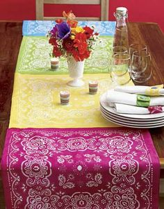 Bandanna Table Runner - Just sew together along the edges or attach with iron-on bonding.......great for summer parties or family reunions.  Or just an everyday table setting.