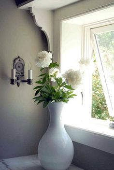 pretty peonies, and the walls are gray (shale, classic color #861 by Benjamin Moore)