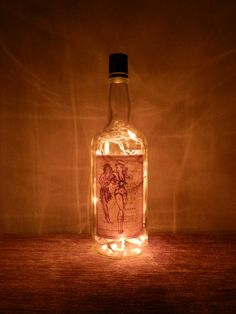 One liter Sailor Jerry bottle.  Amber lights on white wire.  Wonderful night light or bar accent light.    Pinup girl on the inside of the label shows