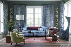 Hable Smith designed the cotton-silk fabric covering a George Smith sofa in the den (also known as the keeping room), the Belgian armchairs are from John Derian, and the cocktail table came from a flea market in Provincetown; the curtains are Hable Construction's Rope fabric, a Moroccan rug is layered over an African palm-frond mat, and the walls are painted in Farrow & Ball's Castle Gray.   - ELLEDecor.com
