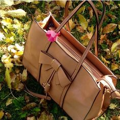 Super Gorgeous Bow handbag!! Cute tan color handbag from Expressions nyc!! Got lots of compliments!! Used few times..everything is perfect condition except der is loose stitch from right lower side corner..posted 4pics.. Expressions NYC Bags Satchels