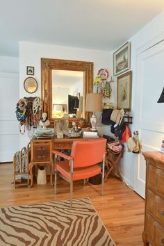 Name: Thomas and Tara Steffen Location: Nashville, TN Size: 2,650 square feet Years lived in: 3 years; Owned Who buys a house based on the wallpaper and lighting fixture in the front entryway? Tara does. She fell in love with her mid-century home the moment she walked in the door. This house, with its bright pops of color and classic lines, is just perfect to house her ever-evolving collections.