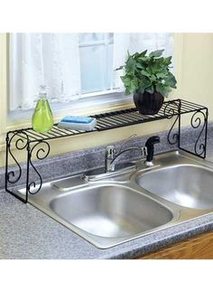 Expandable Over The Sink Shelf  Our camper is small so we use this to help maximize our counter space.