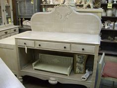 this  was a dresser, drawers  gone,  and  a graceful headboard  for the b ack....