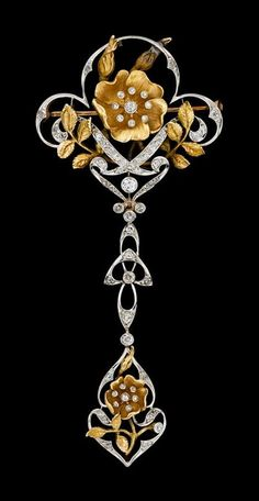 Art Nouveau platinum and yellow gold diamond garland brooch.