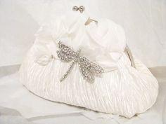 White Bridal Wedding Bag Clutch Formal Wear with Large  Rhinestone Brooch Bridal wedding clutch evening bag. $65.00, via Etsy.