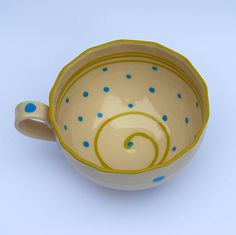 Blue polka dot cup, handpainted with green rim.via Etsy.
