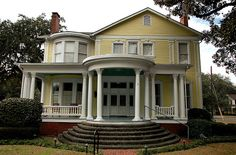 Brunswick GA Glynn County Historic District Yellow Neoclassical Revival Cornithian Portico Architecture House Pictures Photo Copyright Brian Brown Vanishing South Georgia USA 2011