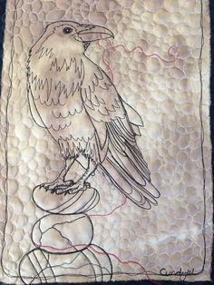 Raven with the red thread 1. Free Motion Quilted on Hand Dyed Silk. By Textile Artist and Art Quilter Cindy Watkins