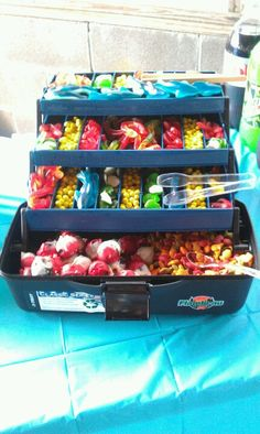 For a Underwater or Fishing Party. Fill a takle box with gummy worms,frogs,sharks & any other candy related to fishing!!