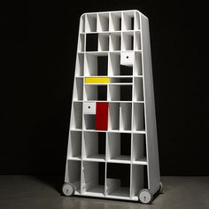 Moving Mondrian, by Vladimír Ambroz - Moving Mondrian features doors and drawers in primary colours that can be moved around within the white frame
