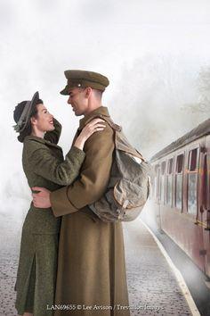 Lee Avison 1940S COUPLE SMILING ON TRAIN PLATFORM Couples