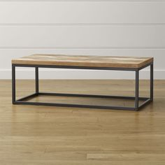 """Natural wood mixes with a dark bronze tubular steel frame in a clean and architectural design that adds warmth and texture to the family room or casual living room.  Reclaimed solid teak (7mm thick) top, sanded and finished with clear topcoatSolid mindi wood1"""" steel tube frame with dark bronze powdercoatBuilt-in levelersMade in Indonesia."""
