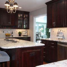 Kitchen dark cabinets light granite, white trim