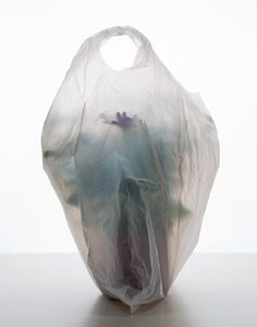 Not really packaging but it is a photo of a woman in a plastic bag...found it strange but compelling