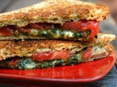 Grilled mozzarella, tomato, and pesto sandwich.