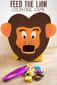 Get crafty and create this feed the lion counting and number game for toddlers and preschoolers. Ideal for those little ones that love to post. This game is ideal for a Zoo Theme or Jungle theme and includes extensions and variations using the same lion f Jungle Theme Activities, Zoo Activities Preschool, Zoo Animal Activities, Preschool Jungle, Jungle Theme Classroom, Zoo Animal Crafts, Toddler Preschool, Toddler Activities, Preschool Activities