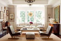 great living room. not a fan of the chairs but you could totally swtich them out for something more traditional