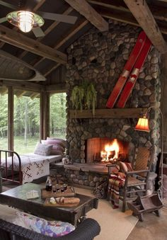 screened in sleeping porch, love the water skis on the fireplace...