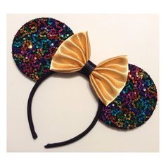 Colorful sequined mouse ears with a black sequin trim. Bow can be chosen in the available colors