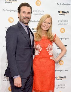 """Does Jon Hamm, a.k.a. Don Draper, decorate his own home? """"Yes and no,"""" he explained. """"When I grew up in St. Louis, all of the family would come over to my grandmother's house, where I lived. So it got very festive. There was a sort of old tchotchke vibe but very Midwestern. But now that we're older, we don't decorate as much. We're used to being decorated for—we're always traveling."""" Hamm is pictured here with his partner, Jennifer Westfeldt."""