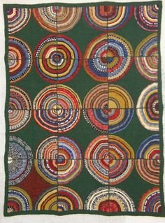 bulls eye hooked rug by Judith Dallegret. raffle rug for Hooked in the Mountains 2012