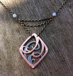 Gemini Necklace and Air Sign // Zodiac Jewelry with Art Nouveau Design - like the idea of stacking 2 pierced metals. Riveted together maybe or maybe just on same bail so that they swing separately?