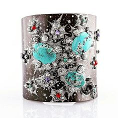 Turquoise Galaxy by Vicente Gracia. The bracelet Galaxy allows us to imitate with precious metals the materials from which the Universe is made of. In this piece combined with turquoises. We use the qualities of oxidised silver to create the sense of depth in this bangle depicting the beauty of the Galaxy. The small shining effects of silver serve as twinkling stars whilst the nodules of textured metal represent the mysterious matter found floating in space. __________  Turquoise Gslaxy de…