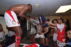Vieira and the team celebrate in the changing rooms at White Hart Lane, 25/05/04. #Arsenal